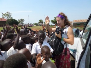 Laura surrounded by school children